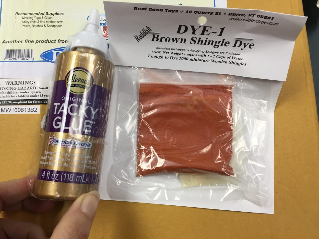 A picture of the tacky glue and brown shingle dye.