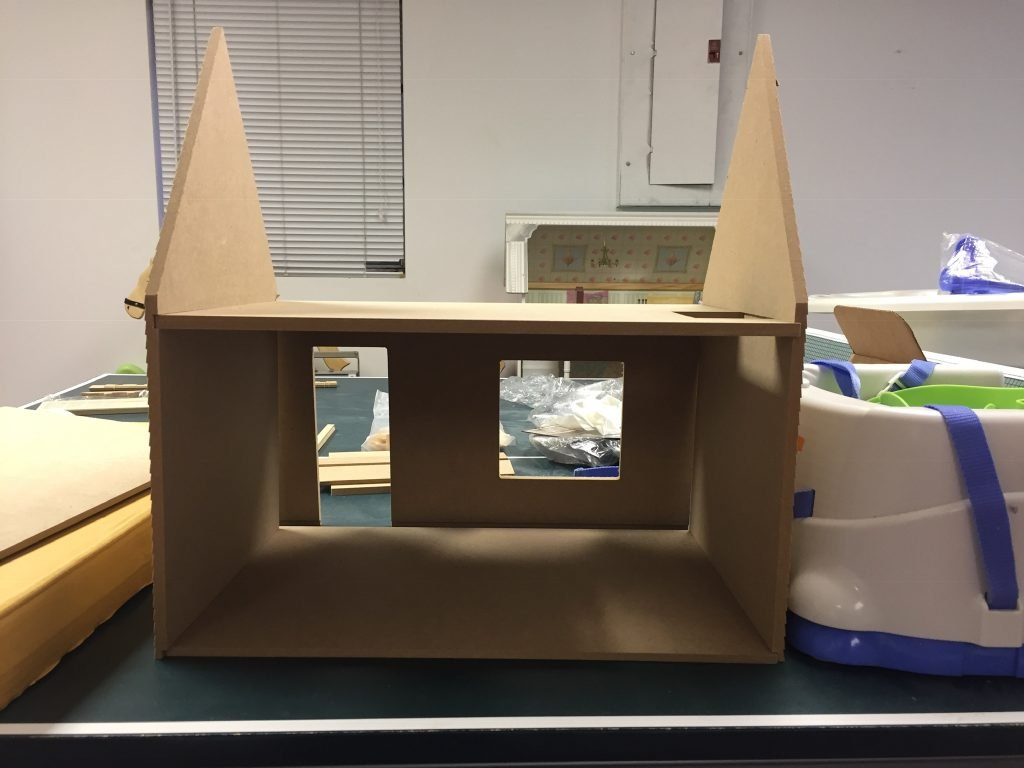 The half-assembled dollhouse kit (without the roof) so I could make sure I was doing this right!