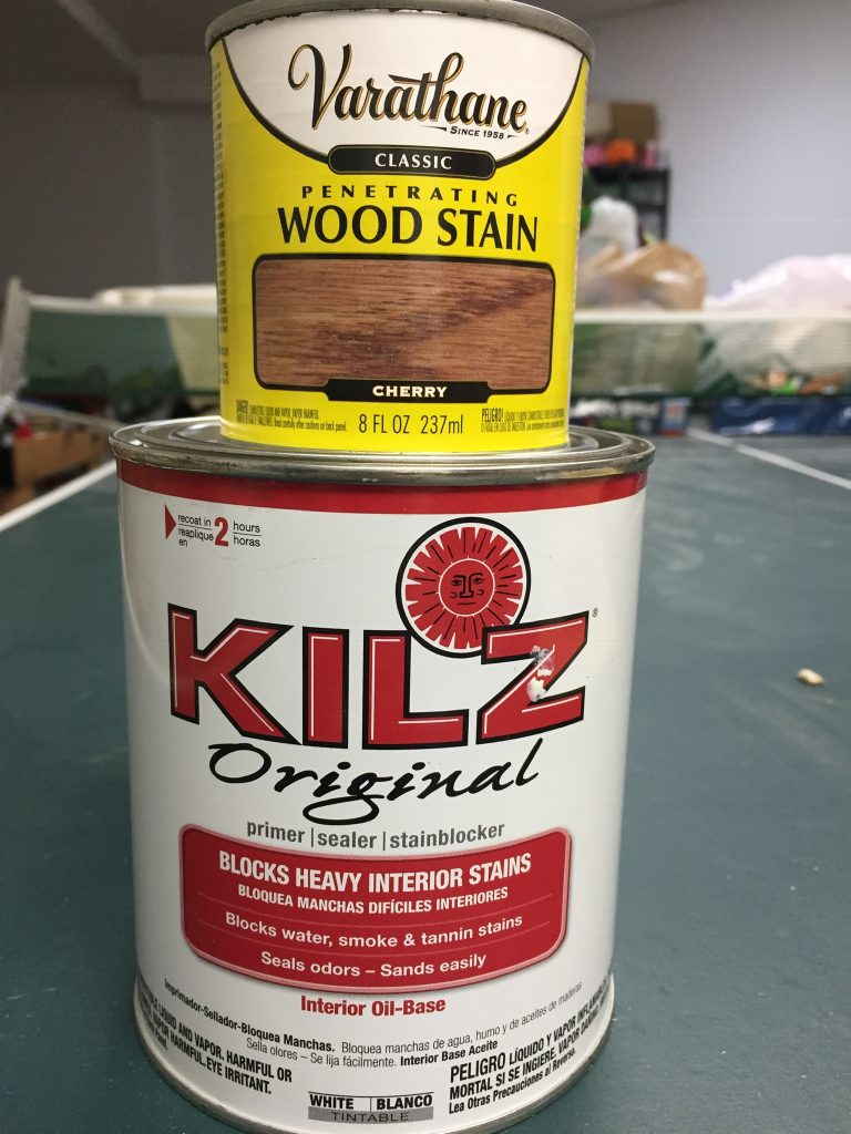 A picture of Kilz primer and some wood stain.