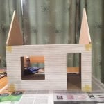 A picture of the dollhouse shell before I started painting it.