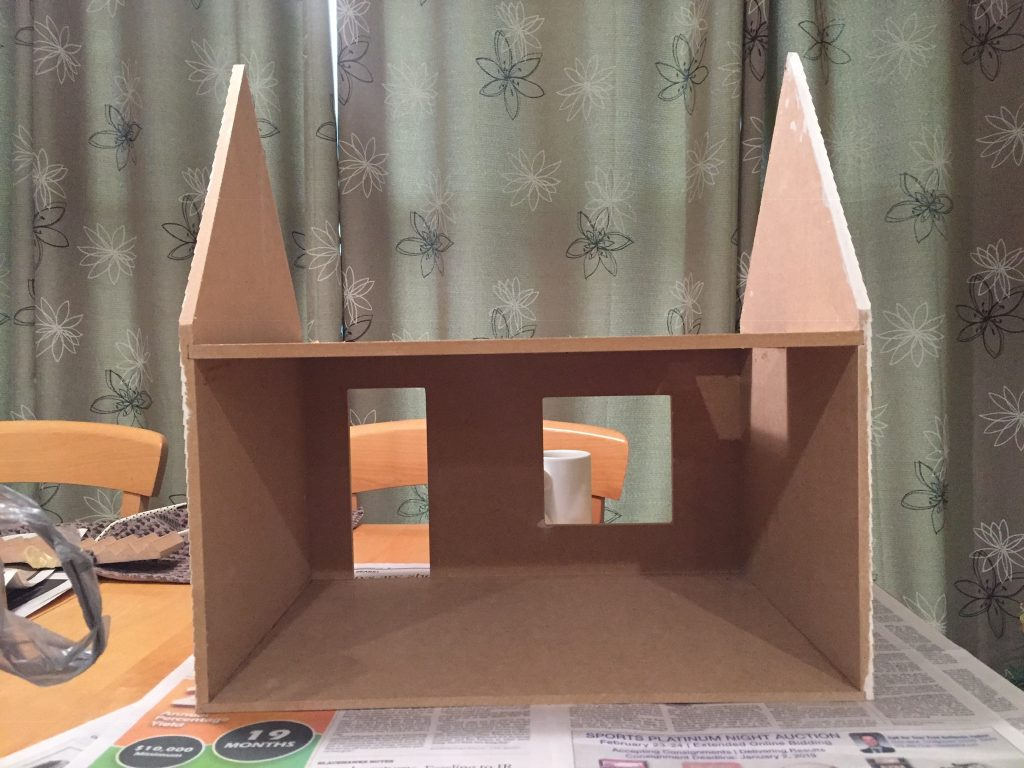 A picture of the backside of the dollhouse shell without the room dividers.