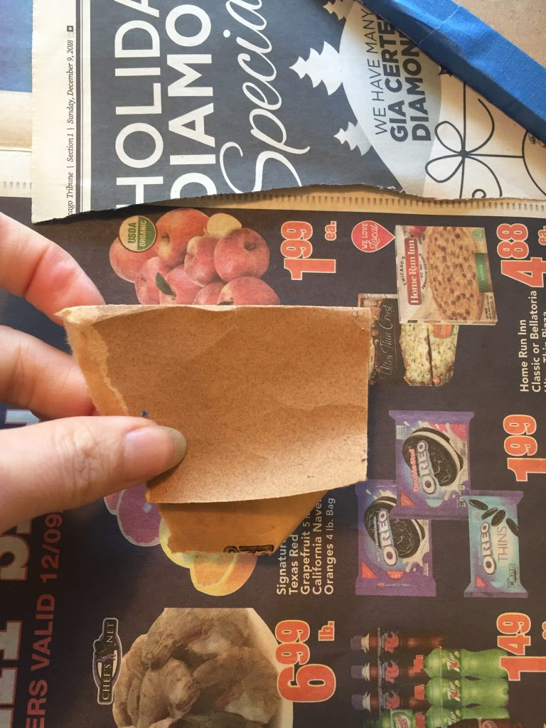 A picture of properly folded sandpaper. It's flat all the way across.