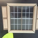 A picture of the partially assembled window with the shutters in place