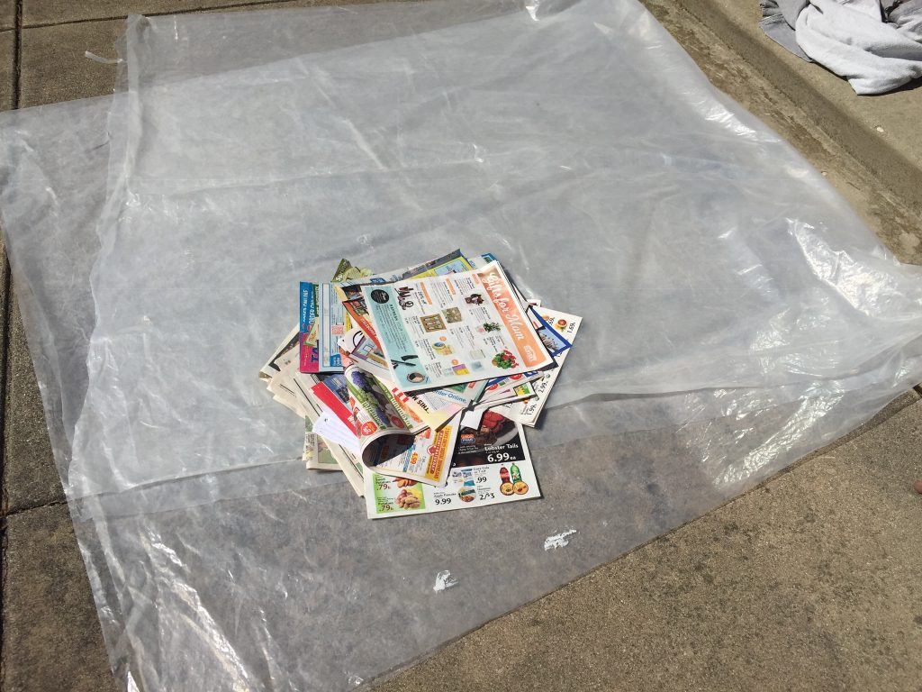 A picture of my plastic tarp and newspaper pile