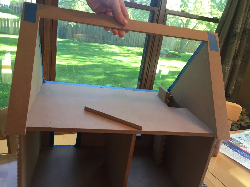 A picture of me dry fitting the rear roof to the dollhouse