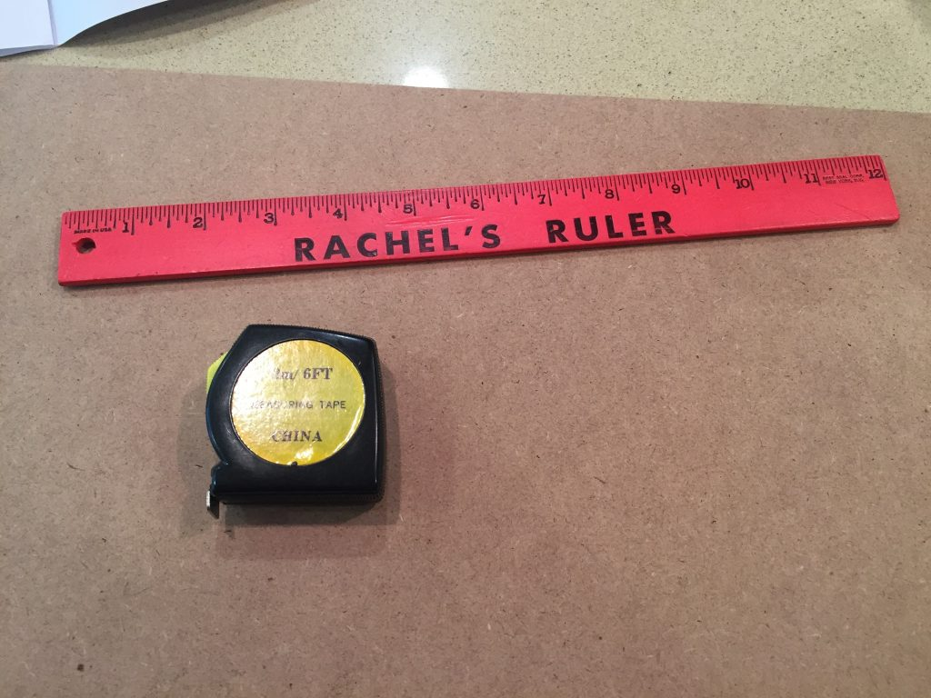 A picture of a ruler and a tape measure