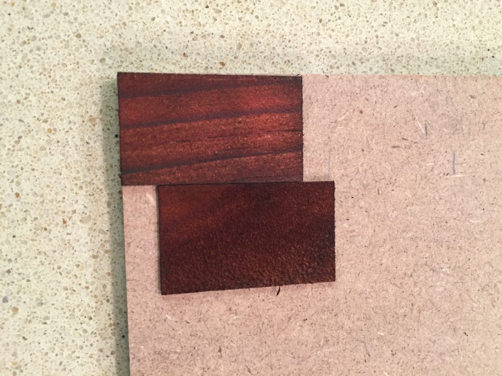 A picture of two dollhouse shingles laid out following the different roof lines.
