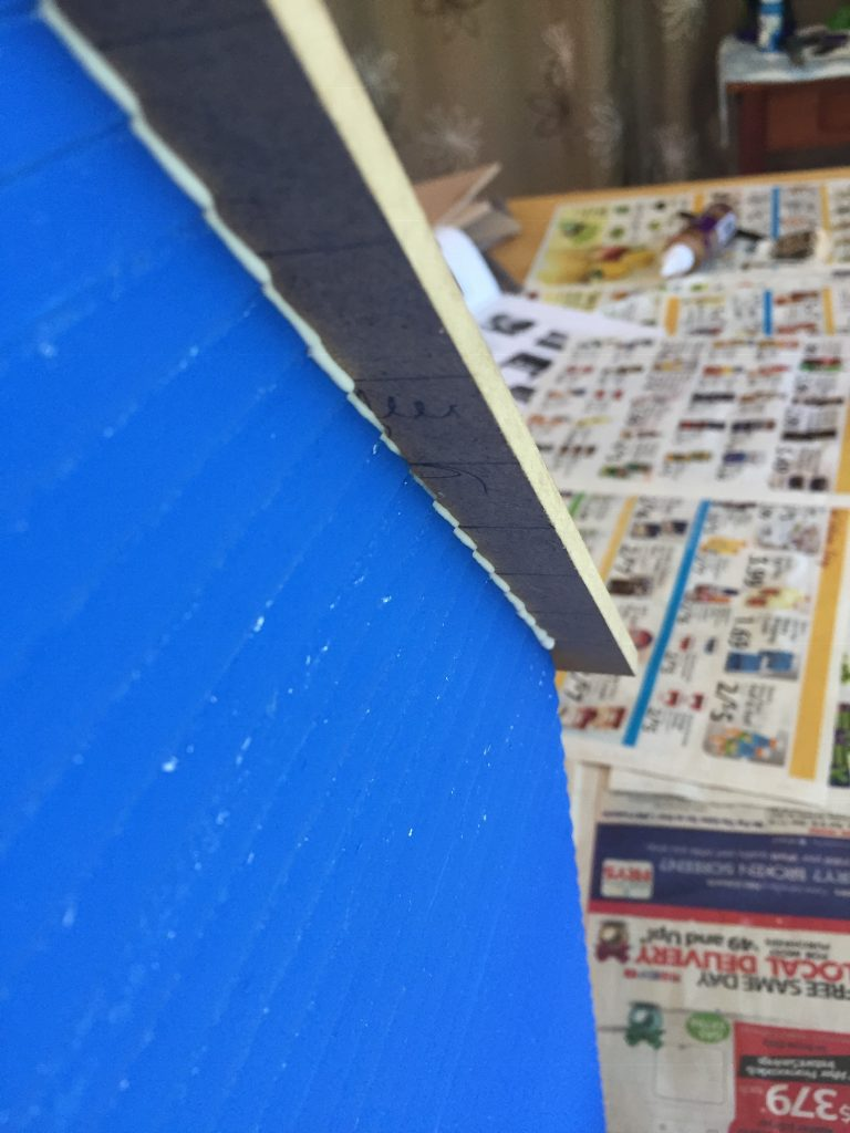 A picture of the glue from the roof leaking on to the outside of the dollhouse