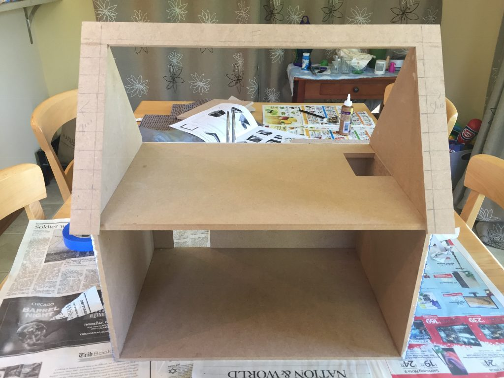 A picture of the rear roof glued to the dollhouse