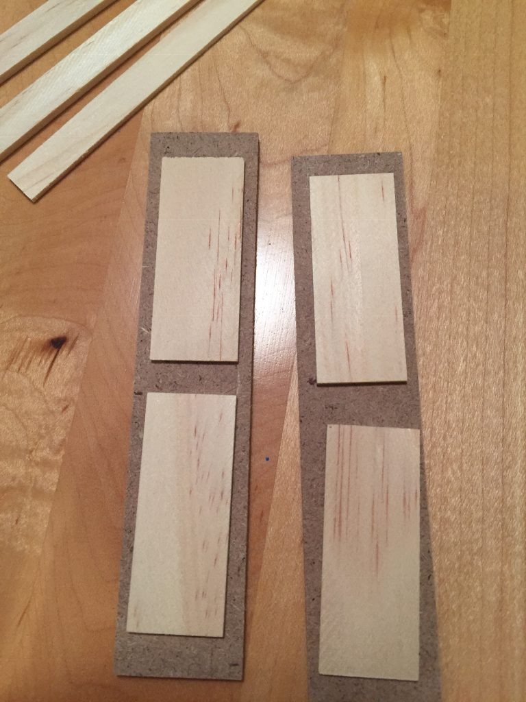 A picture of the window shutters without paint. The wood is two different kinds of wood.