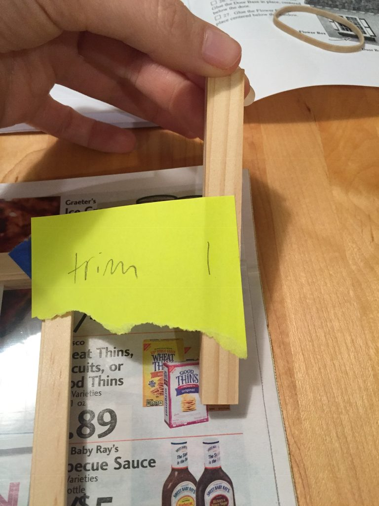 """A picture of the possible window divider. I have it marked as """"trim."""""""