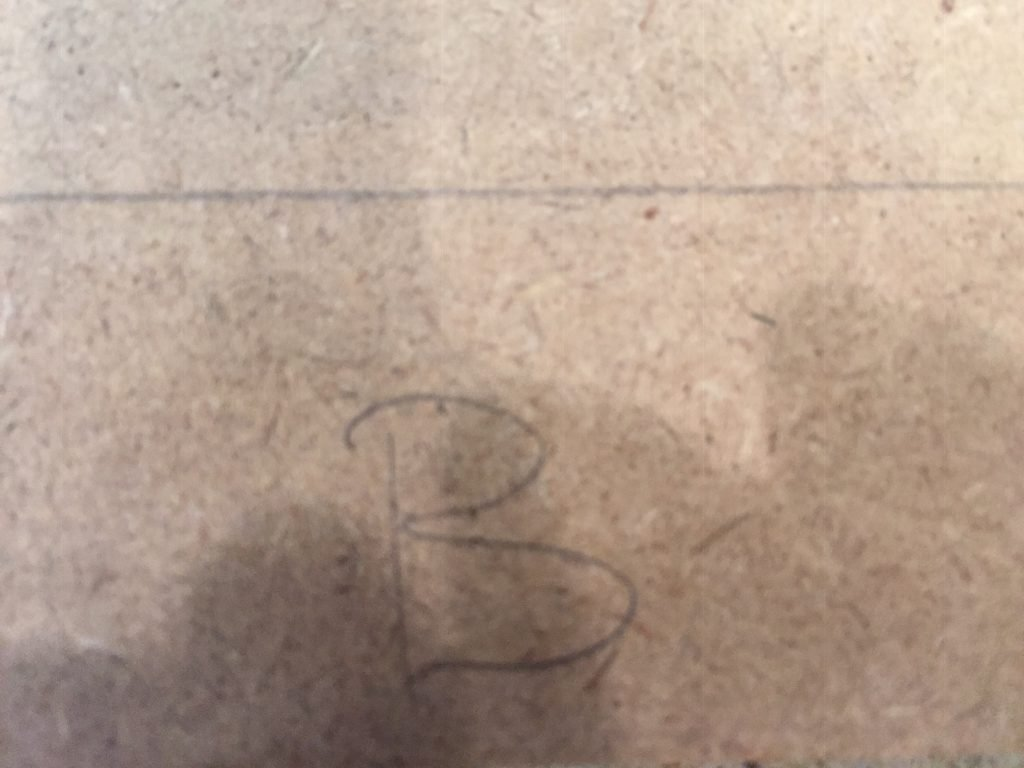 """A picture of the roof piece with the letter """"B""""on it."""