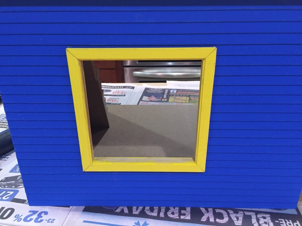 A picture of the window frame with all four pieces sitting perfectly in the opening.