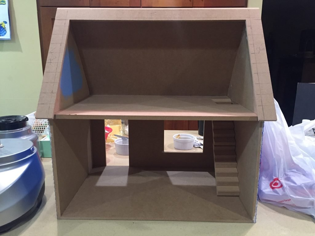 A picture of the dollhouse without any room dividers.