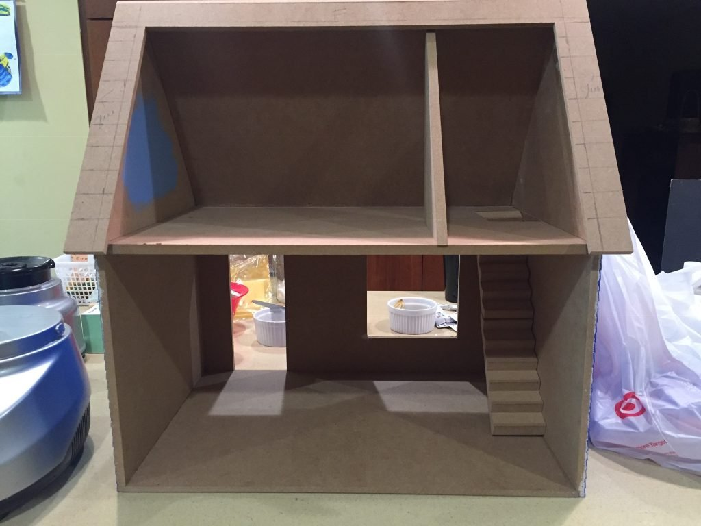 A picture of the dollhouse with the upstairs divider on the far right.