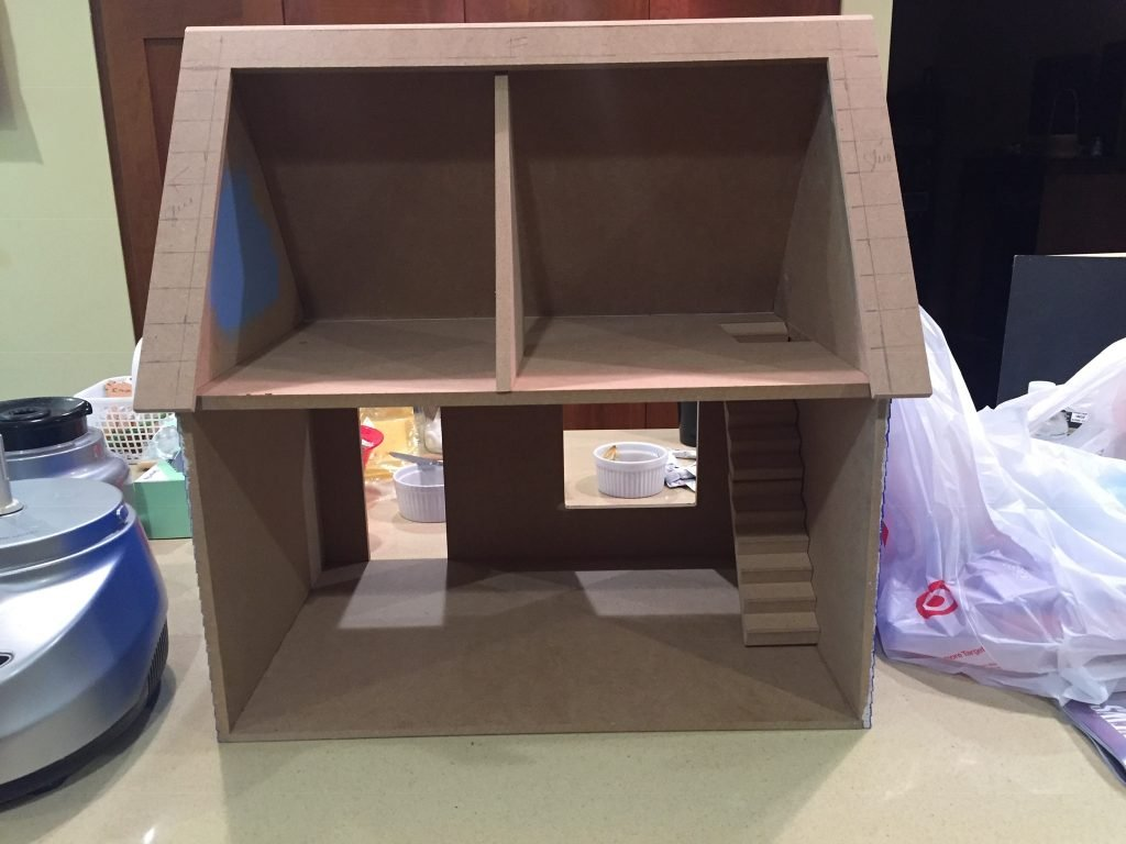 A picture of the dollhouse with the upstairs divider in the middle.