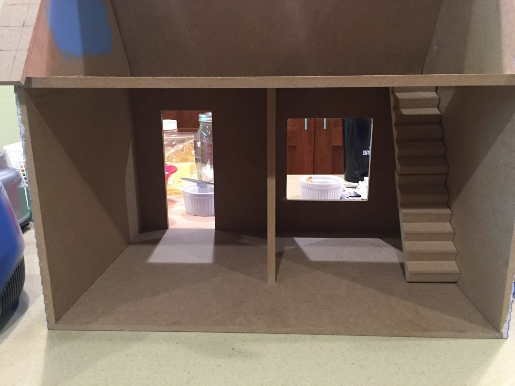 A picture of the dollhouse with the bottom room divider in the middle of the room