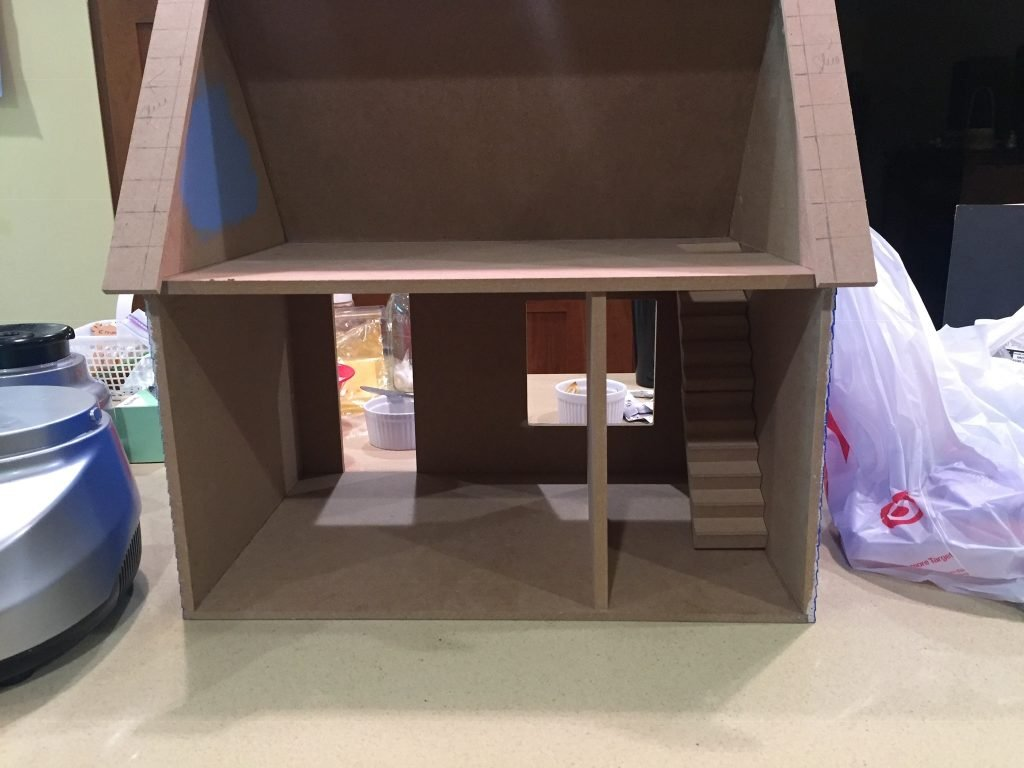 A picture of the dollhouse with the bottom room divider closer to the stairs