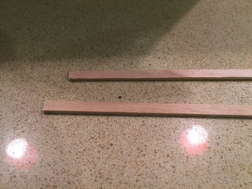 A picture of two of the balsa wood sticks.