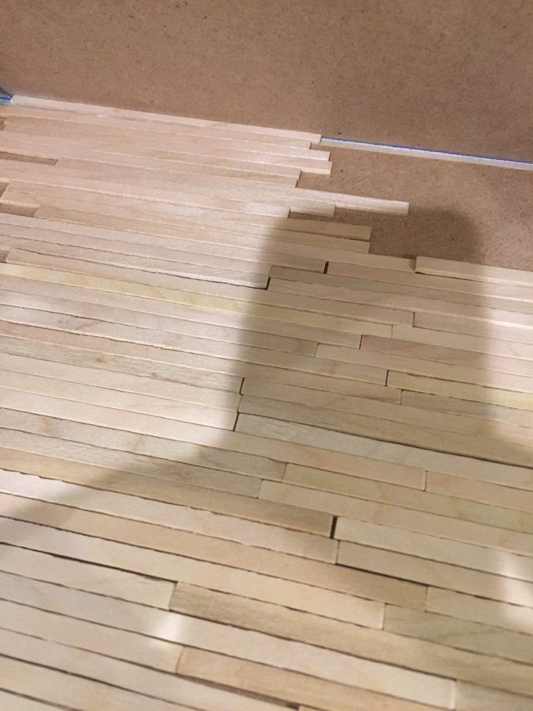 A picture of the balsa wood planks laid out in a random pattern.