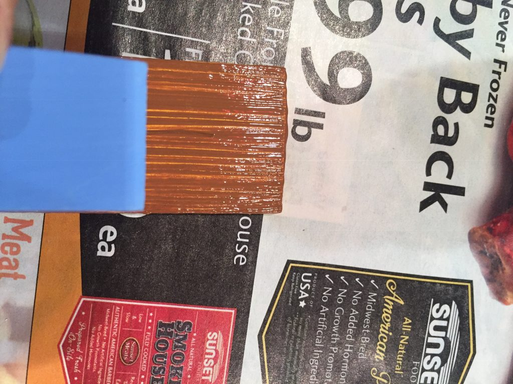 A picture of the blue accent piece for the shutter held up to the still wet shutter piece,