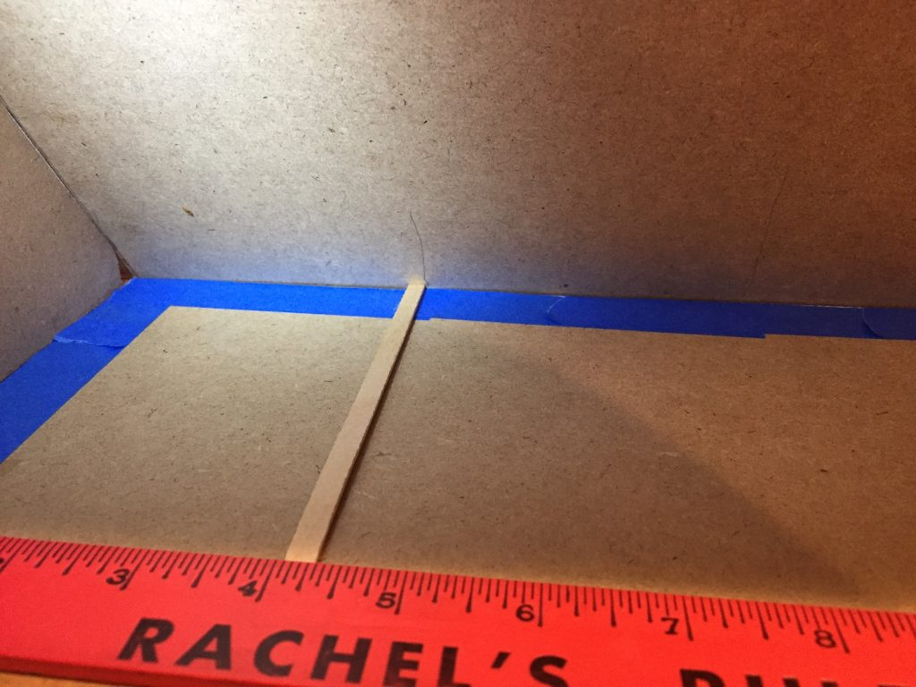 A picture of 4 and one quarter inches marked off with a balsa wood stick.