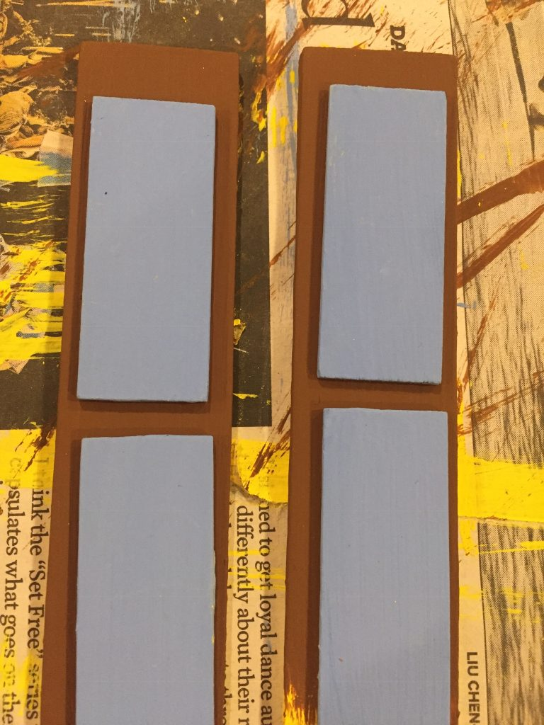 A picture of the repainted shutters dry fit with the accent pieces.