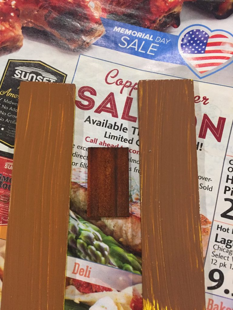 A picture of the two shutters in both browns with the dollhouse shingle between them.