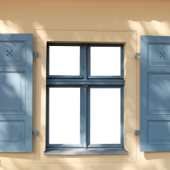 A stock picture of a window with shutters