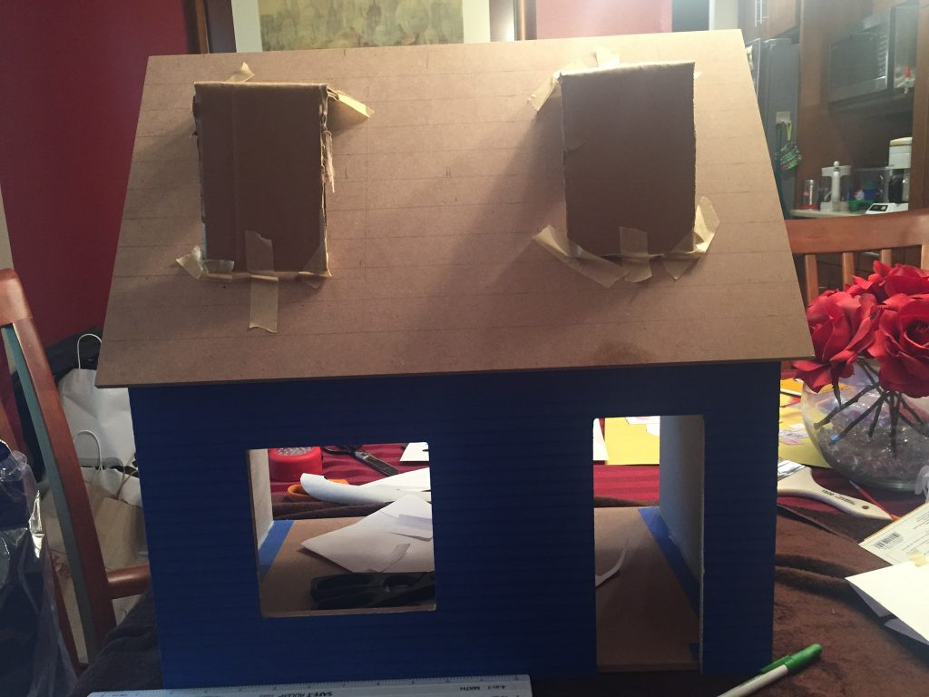 A picture of the Keeper's House with cardboard dormers on the roof