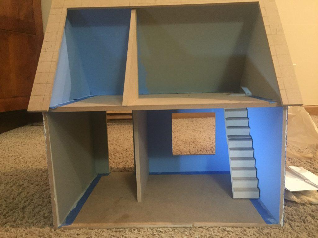 A picture of the dollhouse with the walls in place
