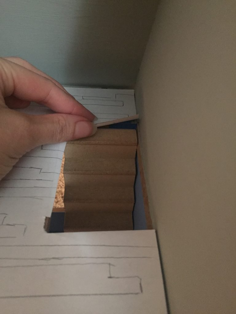 A picture of the template for the upstairs dollhouse floor with the stairs in place.