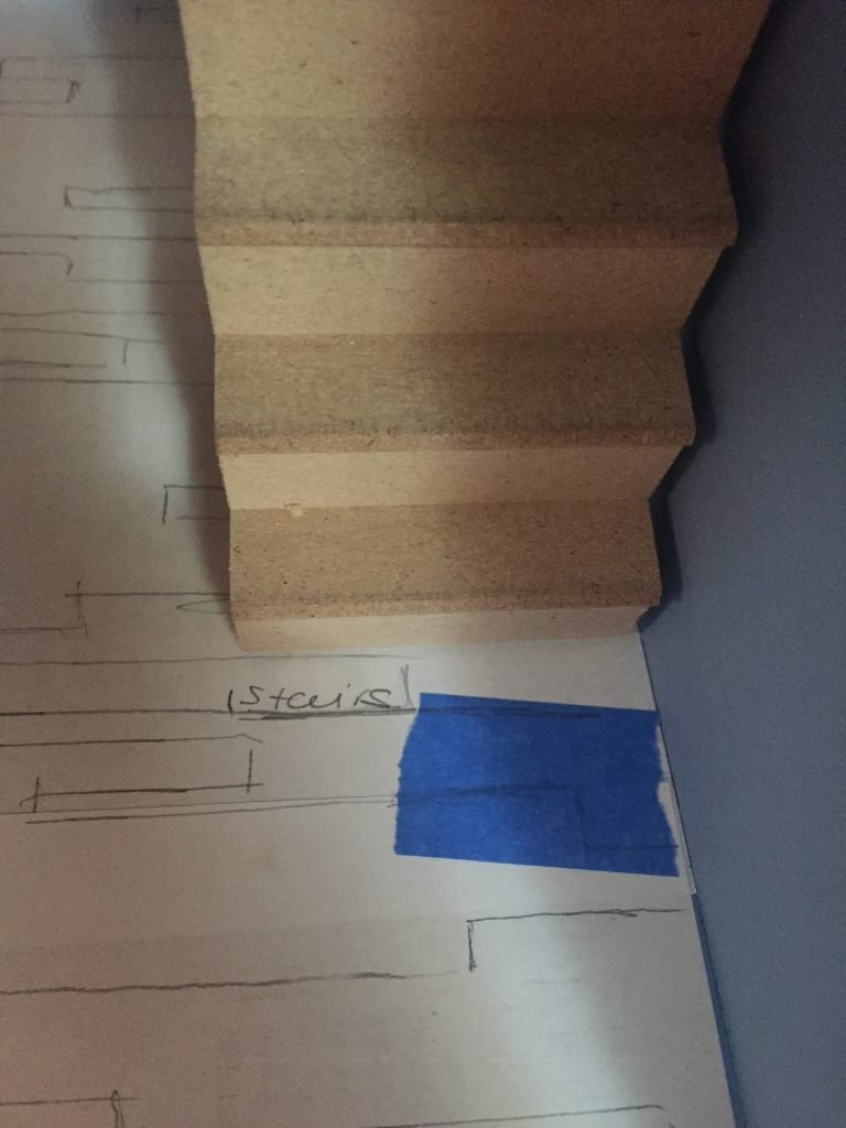 A picture of the dollhouse wood floor template where I marked the stairs. It's mostly a guess.