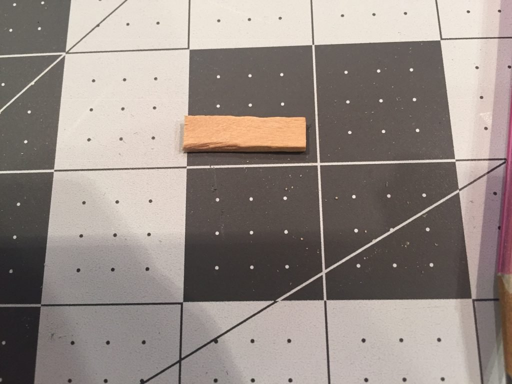 A picture of a tiny piece of balsa wood I cut using the risers and miter box.