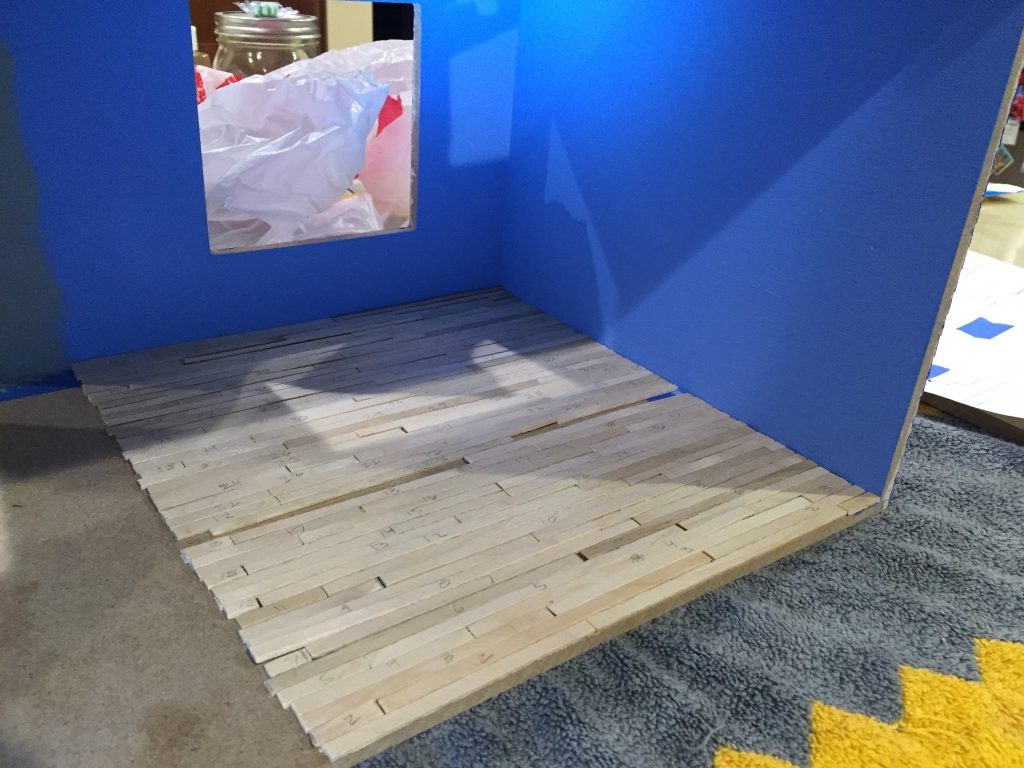 A picture of the nearly complete wood floor in the dollhouse.