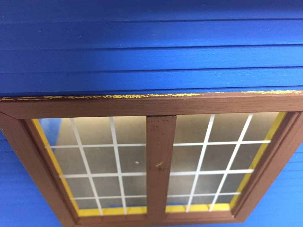 A top down view of the window showing where touch-up painting needs to happen