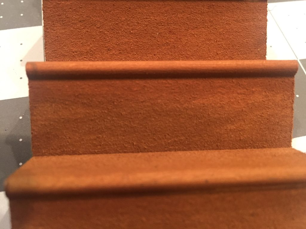 A picture of the uneven paint job on the stairs