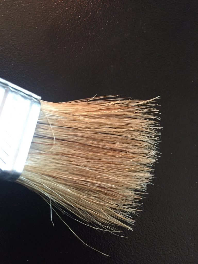 A picture of a paintbrush with the bristles spread out
