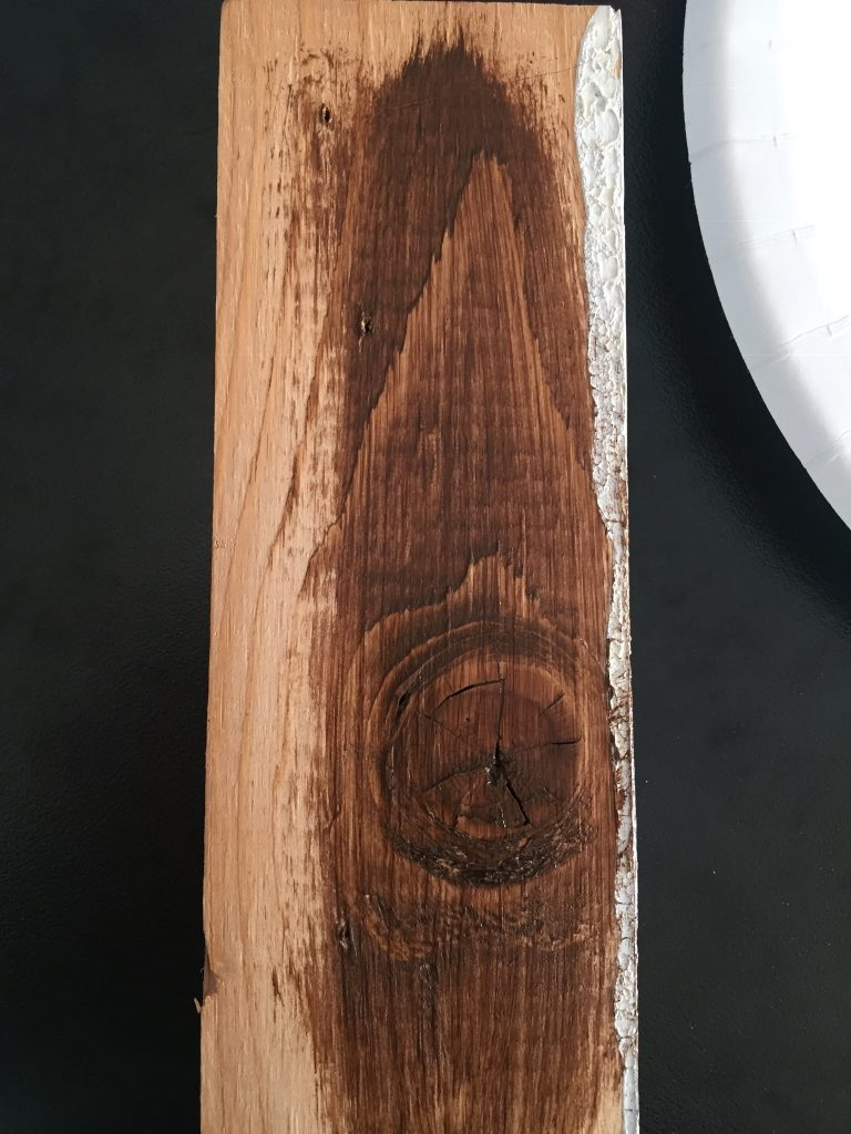 A picture of the test wood with uneven gel wood stain on it