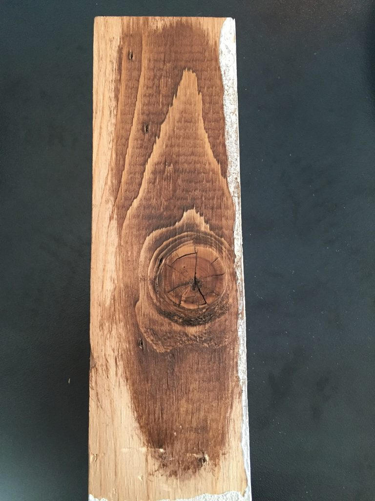 A picture of the scrap wood with several layers of wood gel on it.