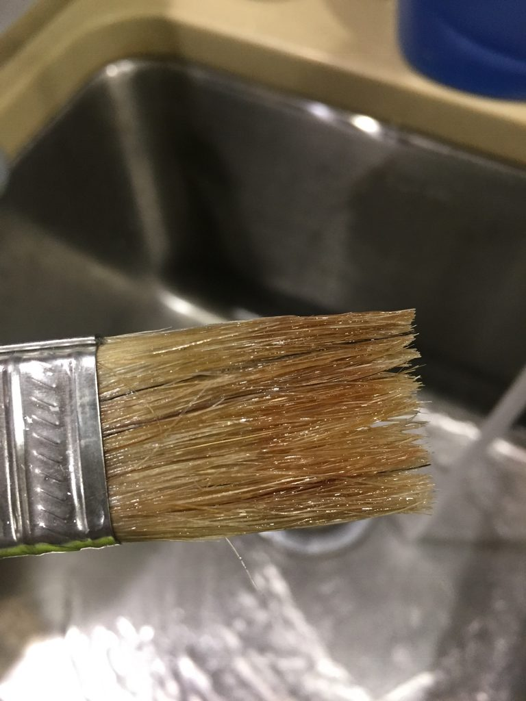 A picture of the paint brush I used for the gel wood stain after the second rinse in oil