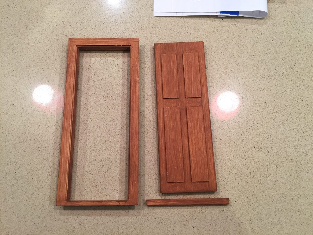 A picture of the painted door, frame, and door step