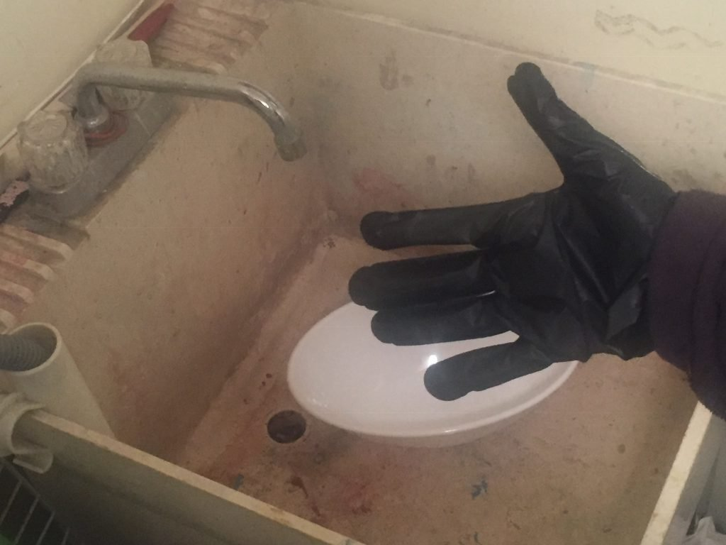 A picture of a glove protecting my hand from the Rit dye bath.