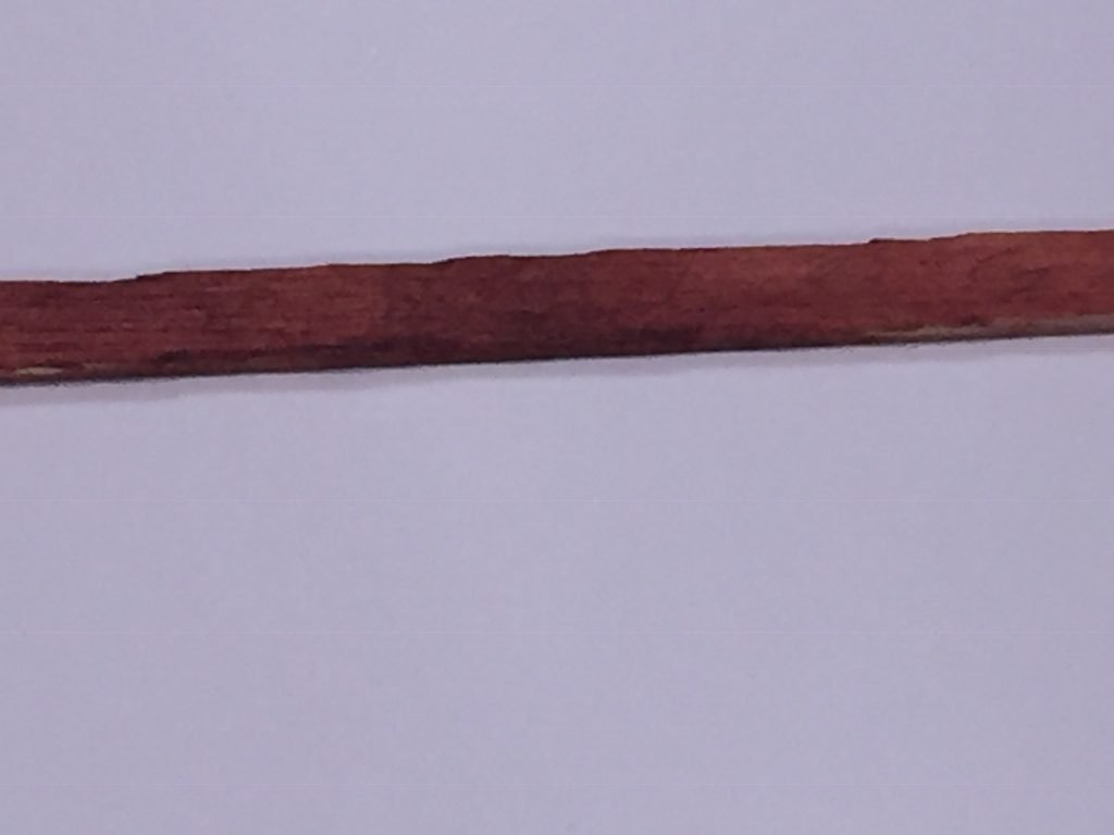 A close up of the numbered balsa wood stick with a close up of the blotchy area.