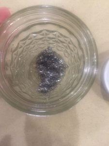 A picture of the steel wool in the jar