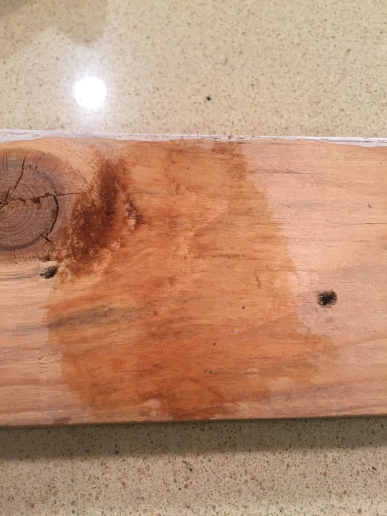 A picture of the cold brew homemade wood dye on the wood when wet