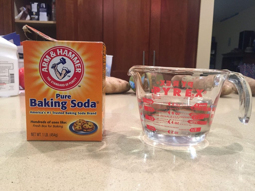 A picture of baking soda and water for weathering dollhouse shingles