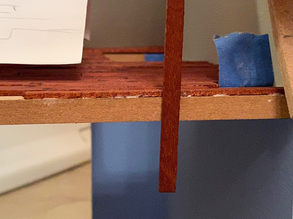Aligning the floorboard with the outer edge of the dollhouse