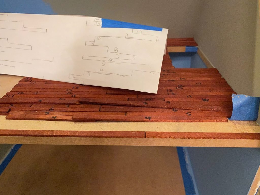 The first row of floorboards glued in place