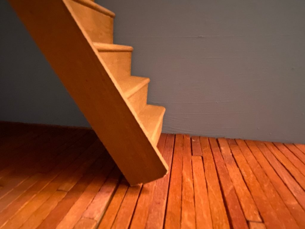 A close up side view of the stairs on the floorboards